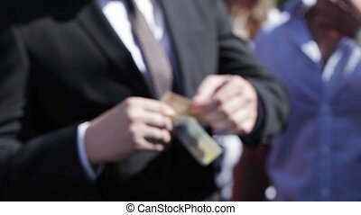Money in hands on wedding - Groom holding money in hand on...