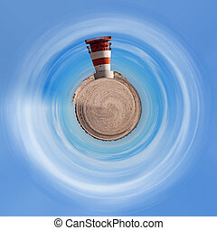 Planet of lighthouse at heligoland dune island with blue sky...