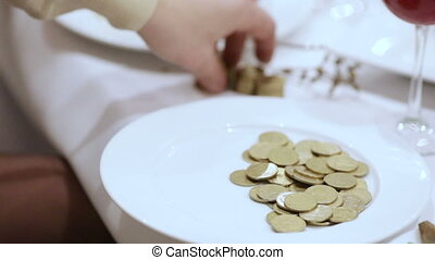 Counting coins on banket - Man considers coins and puts them...