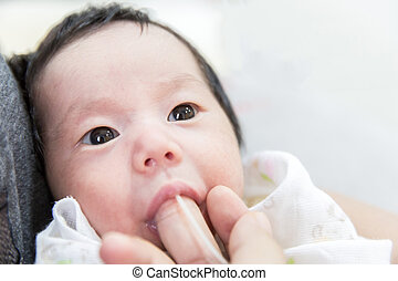 Finger Feeding baby - newborn baby finger feeding milk using...