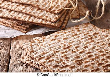 Jewish kosher matzah macro on a table. horizontal - Jewish...
