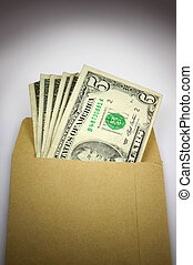 Bribery - Brown envelope full of cash, bribery and...