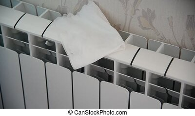 Female hand in rubber glove cleans heating radiator - Female...