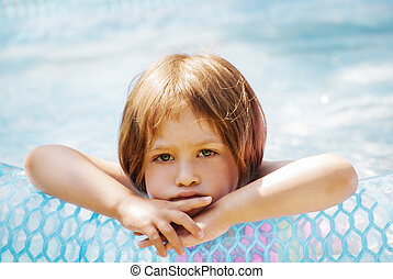 Bad mood - Thoughtful little girl in the pool, outdoor.
