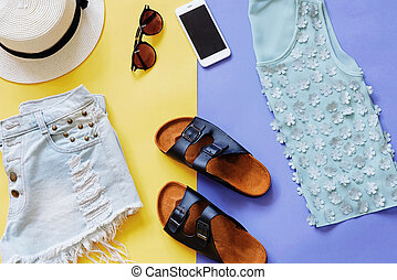 Flat lay style of summer clothes and accessories on colorful...