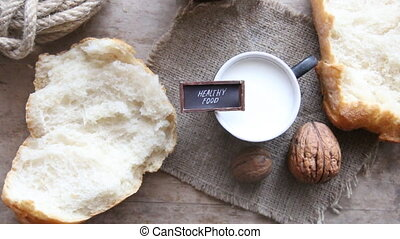 healthy food concept - Fresh Bread on old wooden table and...