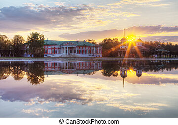 Farmstead Count Sheremetev Kuskovo at sunrise with reflection in a pond, Moscow