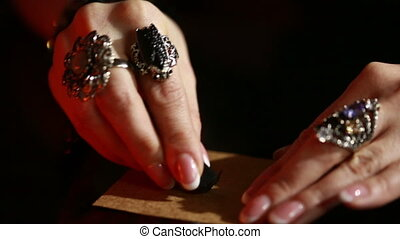 Divination runes. ritual black magic. Rings on the fingers