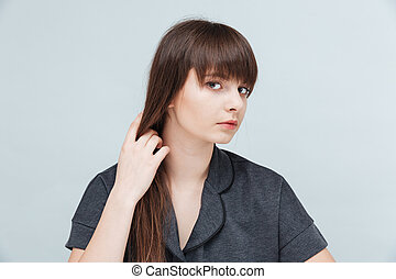 Portrait of a young cute woman looking at camera