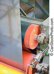 machine role and zinc sheet inside of steel plant