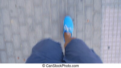 Timelapse of male feet walking on sidewalk - Timelapse shot...