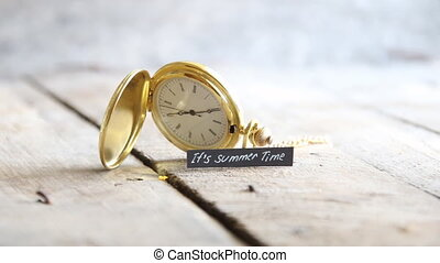Its summer time idea. Hand writing a note and gold pocket...