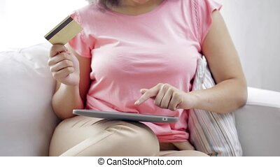 happy african woman with tablet pc and credit card - people,...