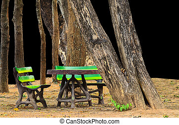 invention bench at pubic park on black background