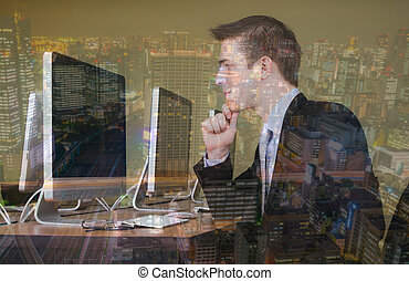 Double exposure of Portrait of young business man working in...