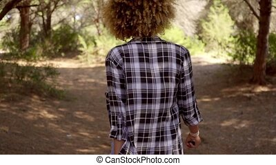Woman in Plaid Shirt Walking on Forest Trail - Mid Torso...