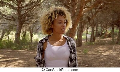 Young Woman Standing in Shady Forest
