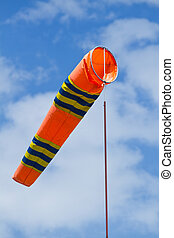 Wind flag windsock in airport on the background blue sky