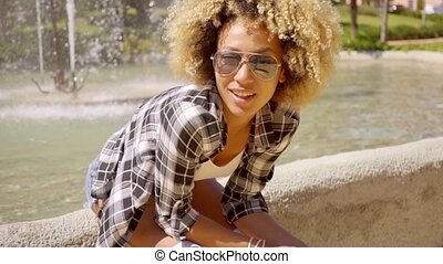 Young Woman With Sunglasses - Young black woman with...