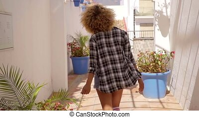 Model Walks The Mediterranean Backyard Along - Young sexy...