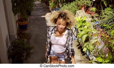Green Narrow Alley - Young exotic african-american woman...