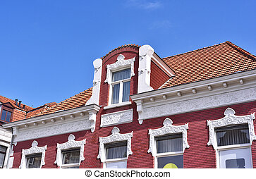 Old town house with dormer and stucco. Art nouveau house...