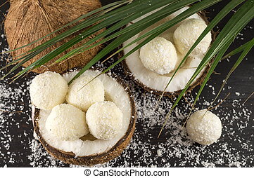 Fresh coconut and coconut cookies on dark background - Fresh...