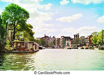 Canal at Amsterdam city, Netherlands Boats and cityscape of...