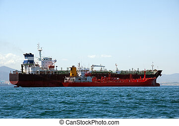 Chemical tanker being refuelled - A chemical tanker which is...