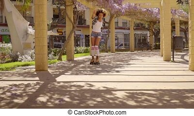 Young Girl On Roller Skates - Slow motion view of young...