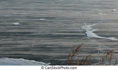 Winter winds on Lake Baikal - A strong wind blows and it...