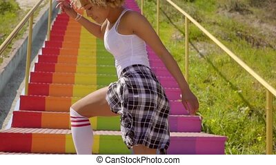 Young Woman Dancing On The Stairs - Young black woman in...