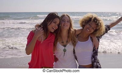Young People On The Beach - Three young sexy girlfriends...