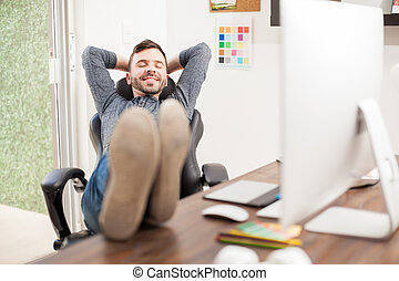 Young man taking a nap at the office - Attractive young man...