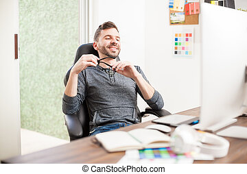 Happy designer taking a break at work - Portrait of a...