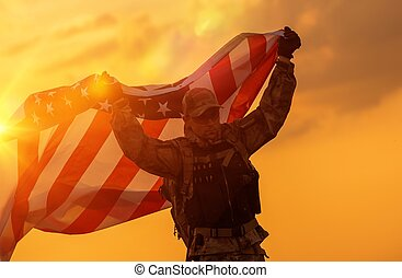 Soldier Celebrating Victory Running with Large American Flag...
