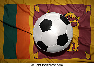 black and white football ball on the national flag of sri...