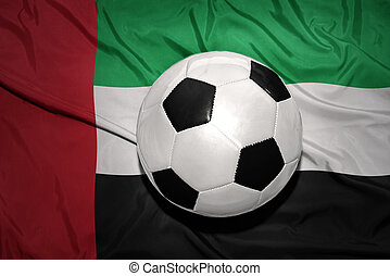 black and white football ball on the national flag of united...
