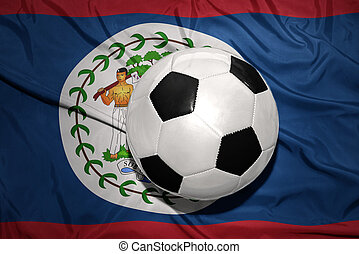 black and white football ball on the national flag of belize...