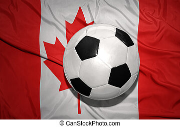 black and white football ball on the national flag of canada...