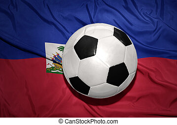 black and white football ball on the national flag of haiti...