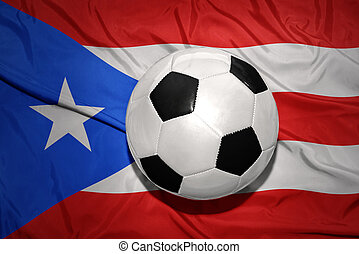 black and white football ball on the national flag of puerto...