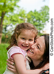Mother spending happy time with her child - Portrait of...
