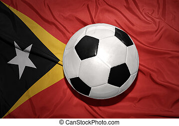 black and white football ball on the national flag of east...