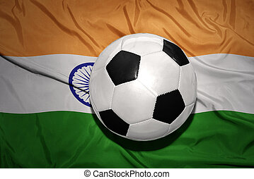 black and white football ball on the national flag of india...