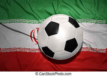 black and white football ball on the national flag of iran -...
