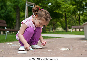 Girl drawing with chalk - Small cute girl drawing with chalk...
