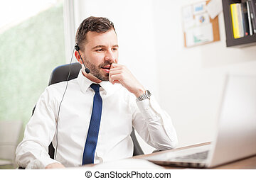 Customer service rep working in an office - Portrait of a...