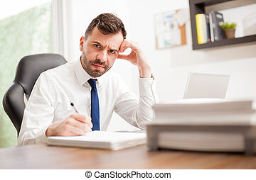Businessman angry and overwhelmed with work - Portrait of an...