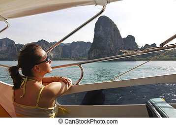 Young woman on boat trip
